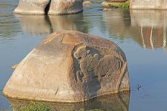 Holy Sacred cow is carved from solid stone on the river Tungabhadra in Hampi stock photography