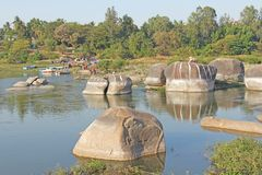 Holy Sacred cow is carved from solid stone on the river Tungabhadra in Hampi stock image