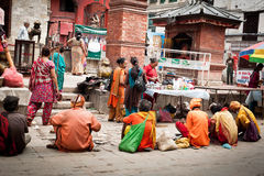 Holy Sadhu men  blessing people at Hindu Temple.. Nepal, Kathmandu,Durbar Square Royalty Free Stock Image