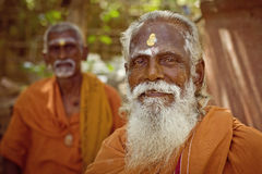 Holy Sadhu men  in saffron color clothing Stock Photo