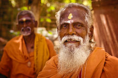 Holy Sadhu men  in saffron color clothing  blessing in Shiva Temple. January 15, 2013 in India, Tamil Nadu, Tiruvanamalai Stock Photo