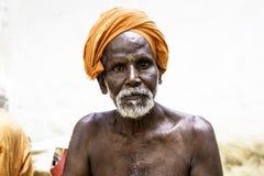 Holy Sadhu men  in saffron color clothing Stock Images