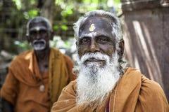 Holy Sadhu men  in saffron color clothing Royalty Free Stock Photos