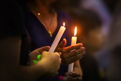 Holy Saturday or Easter vigil mass in church of St. Theresa Hua Hin. Meaning of light in the dark stock photos