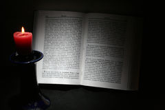 Holy Scriptures and candle Stock Photos