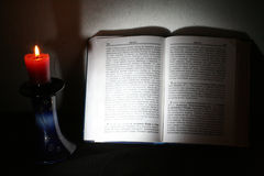 Holy Scriptures and candle Stock Image