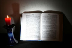 Holy Scriptures and candle Stock Photography