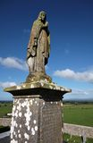 Holy sculpture outside Rock of Cashel in Ireland Stock Photo
