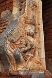 Holy scuplture detail in ancient Myanmar temples. Entrance to an ancient Myanmar temple with a holy scuplture on the gate Royalty Free Stock Photography