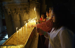 In the Holy sepulchre church. Lighting  Candle in the Church of Holy Sepulchre Royalty Free Stock Photos