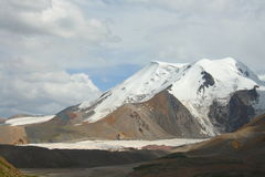 Holy snow mountain Anymachen and glaciers on Tibetan Plateau, Qinghai, China.  Stock Photography