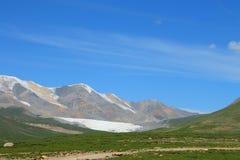 Holy snow mountain Anymachen and glaciers on Tibetan Plateau, Qinghai, China.  Royalty Free Stock Photos