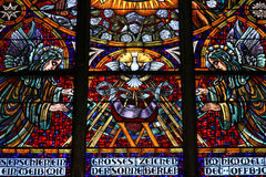 Holy Spirit. Vienna, Austria - colorful stained glass in Votivkirche (Votive Church). Holy Spirit depicted as a dove Royalty Free Stock Images