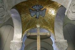 Holy Spirit Bird and Cross. On the church altar Stock Photos