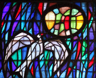 Holy Spirit Bird. Stained glass, Cathedral of St Tryphon is an Roman Catholic cathedral, on June 10, 2012 in Kotor, Montenegro Stock Photos