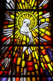 Holy Spirit Dove Symbol. Stained glass of white dove in a Catholic church, the symbol of the Holy Spirit of God Royalty Free Stock Image