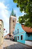 Holy Spirit Lutheran Church and restaurant in blue colour in Telc, Czech Republic. Royalty Free Stock Images