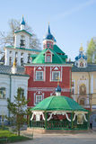 The Holy spring, the sacristy and the bell tower at the Holy Dormition Pskovo-Pechersky monastery. Pskov region Royalty Free Stock Photos