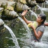 Holy spring water at Tirta Empul Temple Stock Photos