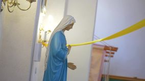 Holy statuette in the Church stock footage