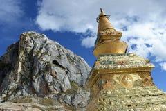 Holy stupa and mountains Stock Image