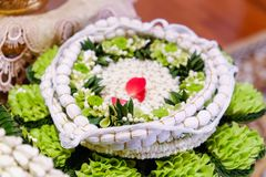 Holy thread on flower tray for wedding ceremony. In Thailand royalty free stock photo