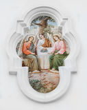 Holy Trinity. The bas-relief on the wall of the temple of the Holy Trinity in the city of Poltava Stock Images