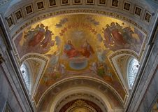 Holy Trinity ceiling painting above the high altar inside the Esztergom Basilica, Hungary. Pictured is a ceiling painting of the Holy Trinity inside the stock image