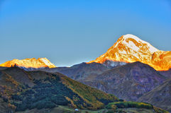 Holy Trinity Church sunrise, Kazbegi, Georgia Stock Images