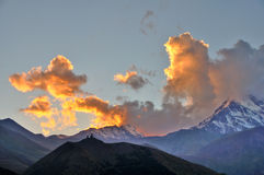 Holy Trinity Church Sunset, Kazbegi, Georgia Royalty Free Stock Photos