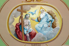 Holy Trinity. Fresco painting on the ceiling of the church royalty free stock image