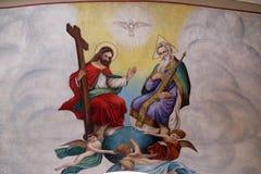 Holy Trinity. Fresco in the church of Saint Matthew in Stitar, Croatia stock photos