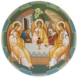 Holy Trinity Icon. Trinity depicts the three angels who visited Abraham at the Oak of Mamre. The classical orthodox painting of the church in Ukraine Royalty Free Stock Images