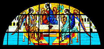 Holy Trinity painted on stained glass in Orthodox Cathedral. Painting on glass in the Cathedral of Sibiu, Romania royalty free stock image