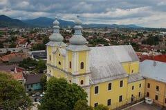 Holy Trinity Roman Catholic Church - Baia Mare, Romania. The Holy Trinity Roman Catholic cathedral in Baia Mare, Maramures county, Romania viewed from Stephen's stock photos