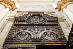 Holy trinity sculpted in wooden door Stock Photos