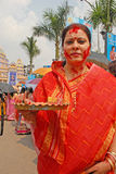 Holy Vermilion. Beautiful Hindu woman smear and play with vermilion during Sindur Khela traditional ceremony on the final day of Durga Puja festival Royalty Free Stock Images