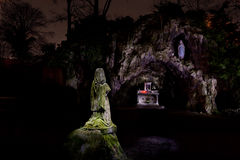 Holy Virgin Mary Grotto Statue lightpainting. A copy of the Grotto of the Holy Virgin Mary of Lourdes in Flanders Leuven, Belgium, with a praying Holy Virgin stock images
