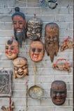 Holy warrior monks wooden carved masks Stock Images