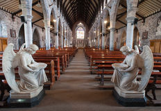 Holy water angels church interior. Holy water angel statues inside church interior stock photo