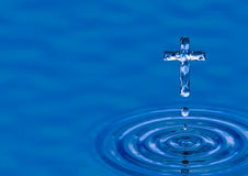 Holy water Cross. Blue water ripple as Holy Cross - religious metaphor of heaven Stock Image
