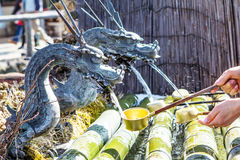 Holy water flowing through the dragon, Japan Stock Photos