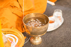 Holy water, the monks and religious rituals in thai ceremony Stock Photos