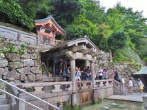 Holy water from Otowa-no-taki waterfall at Kiyomizu-dera temple Stock Photos