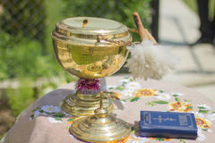 Holy water and prayer. On the festive table is holy water and a book of prayers Stock Images