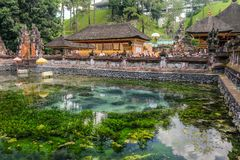 Holy water spring in the Pura Tirta Empul, Bali. Bali, Indonesia - September 9,2017: People visit Holy water spring in the Pura Tirta Empul, Bali, Indonesia royalty free stock photo