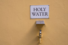 Holy water on tap background Stock Photography
