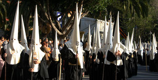 Holy week, Malaga, Spain. Good Friday Procession with people in traditional hooded dress, Malaga, Spain Stock Photography
