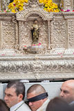Holy Week in Malaga, Spain. Bearers under the throne in Palm Sun Royalty Free Stock Image