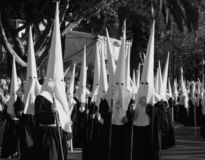 Holy week, Malaga, Spain, black and white. Black and white of Good Friday procession with people in traditional hooded dress, Malaga, Spain Royalty Free Stock Photography